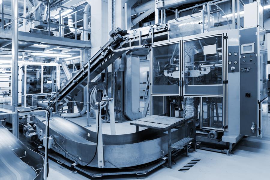 Packaging machine using extruded aluminum framing members
